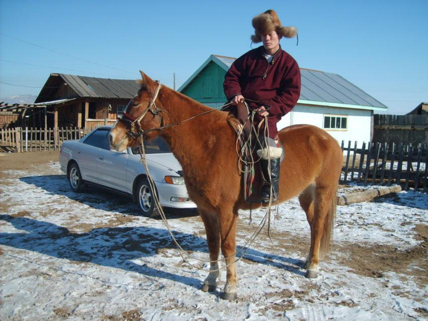 Free photo: Mongolian man riding a horse
