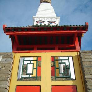 Stupa with eyes of bodhisattva Avalokitesvara in buddhist monastery Dambadarjaalin in Ulaanbaatar, Mongolia, 2007.