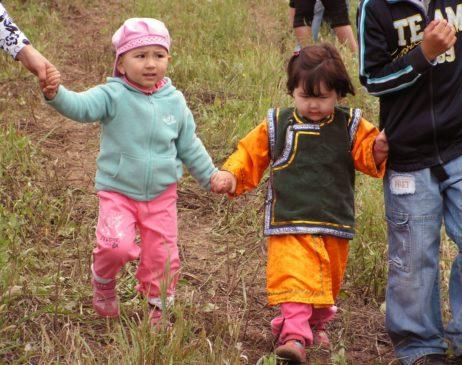 Babies going hand in hand