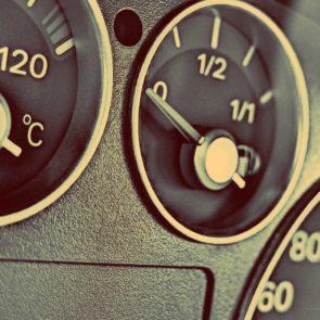 Car Dashboard - The fuel gauge, temperature gauge and tachometer.