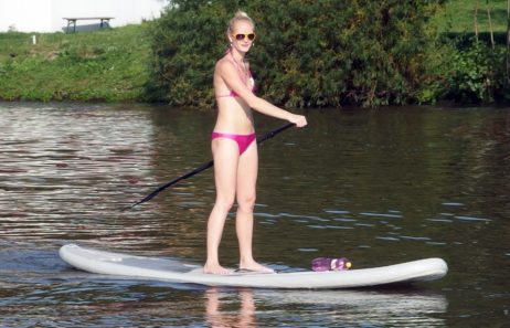 Woman Stands at Paddle Board