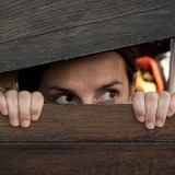 Free photo: Woman playing hide and seek