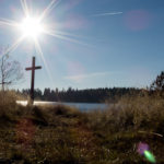 Free photo: Sun over the lake and a crucifix