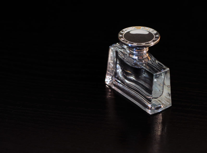 Image of Perfume glass on the black background