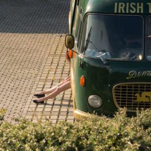 Free image of irish bus and girl's leg