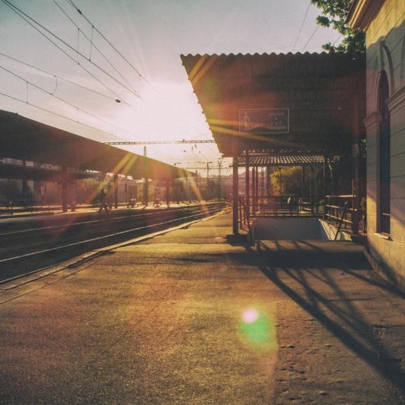 Photo of railway station at sunset