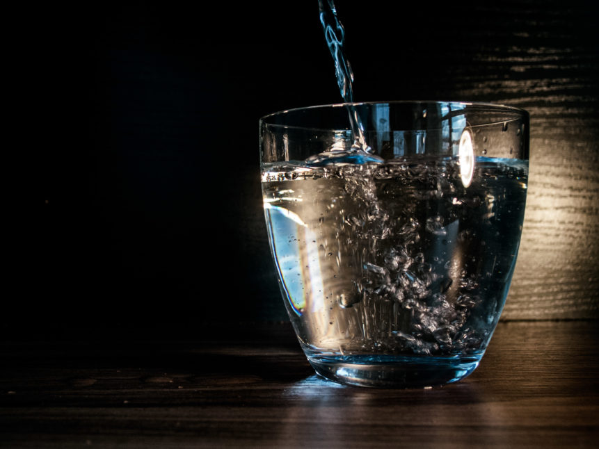 Picture of water flows into the glass