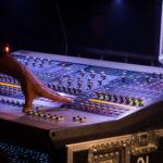 Soundman Behind a Mixer At Concert