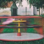 Kids On Children's Playground Carousel