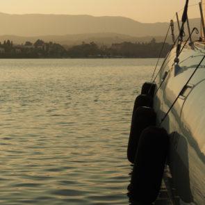 Modern Catamaran In The Harbor At Sunset