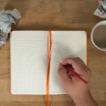 Hand Writing To Open Blank Notebook Mockup
