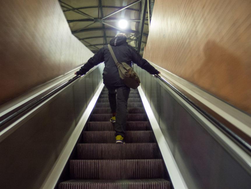 Man On Escalator In Tube