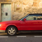 Red Car Cabrio With Grunge Wall