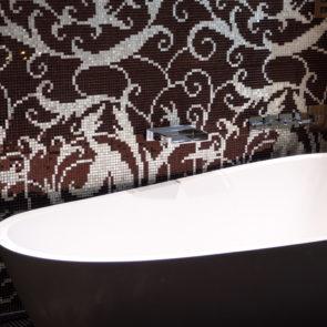 Dark Modern Bathtub In The Bathroom