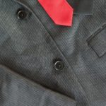 Dark Men's Suit With A Red Tie
