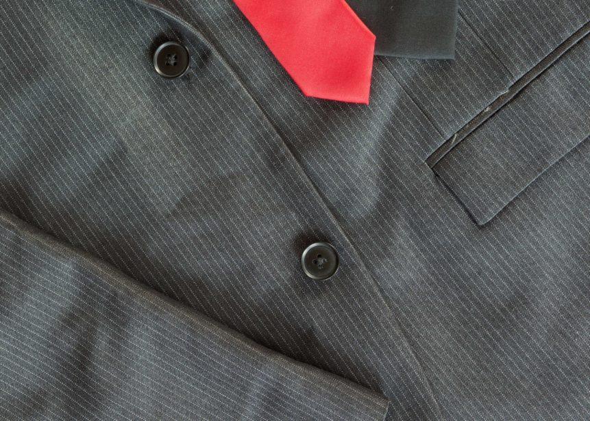 Dark Men's Suit With A Red Tie