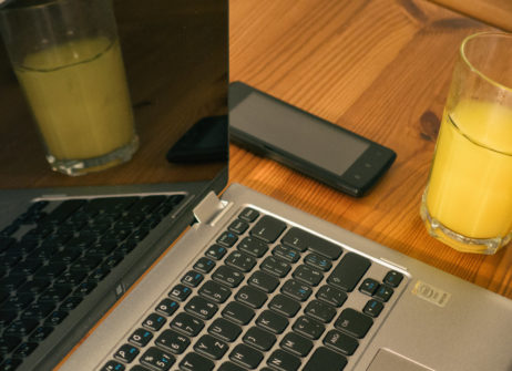 Laptop, Smartphone And Juice On The Wooden Table
