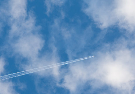 Airplane On The Cloudy Sky