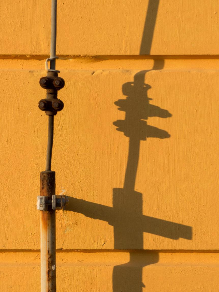 Shadow On Yellow Wall
