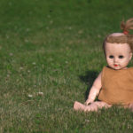Vintage doll on the grass