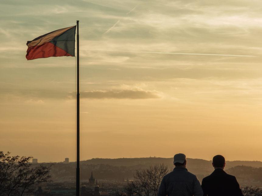 Two men looking to Prague