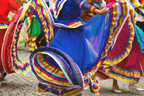 A dancers in a colorful dress