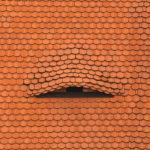 Old dormer window on tiled roof