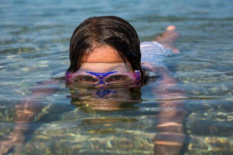 Little girl swimming in the sea