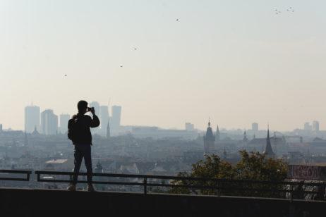 Man shooting cityscape