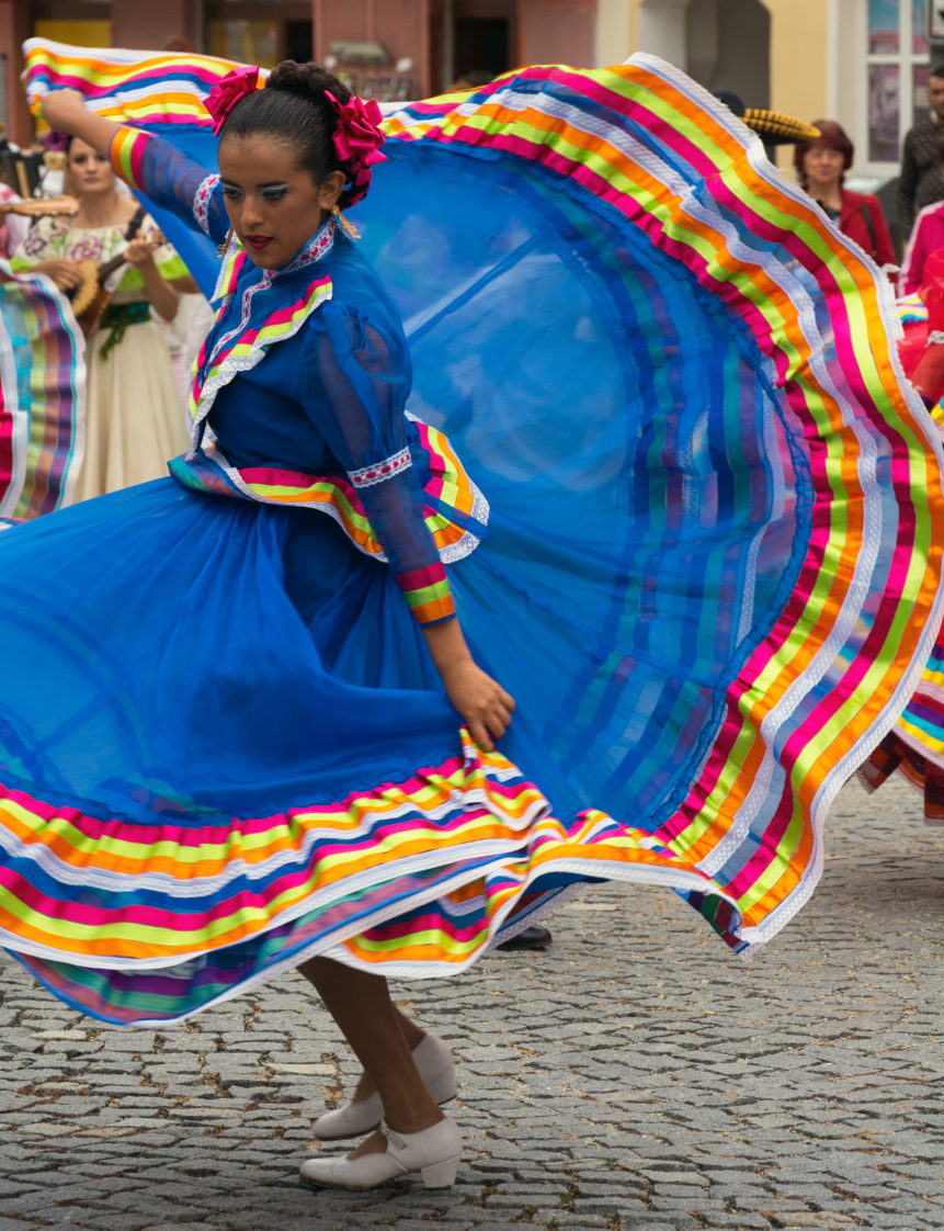 Dancing woman in traditional mexican dress