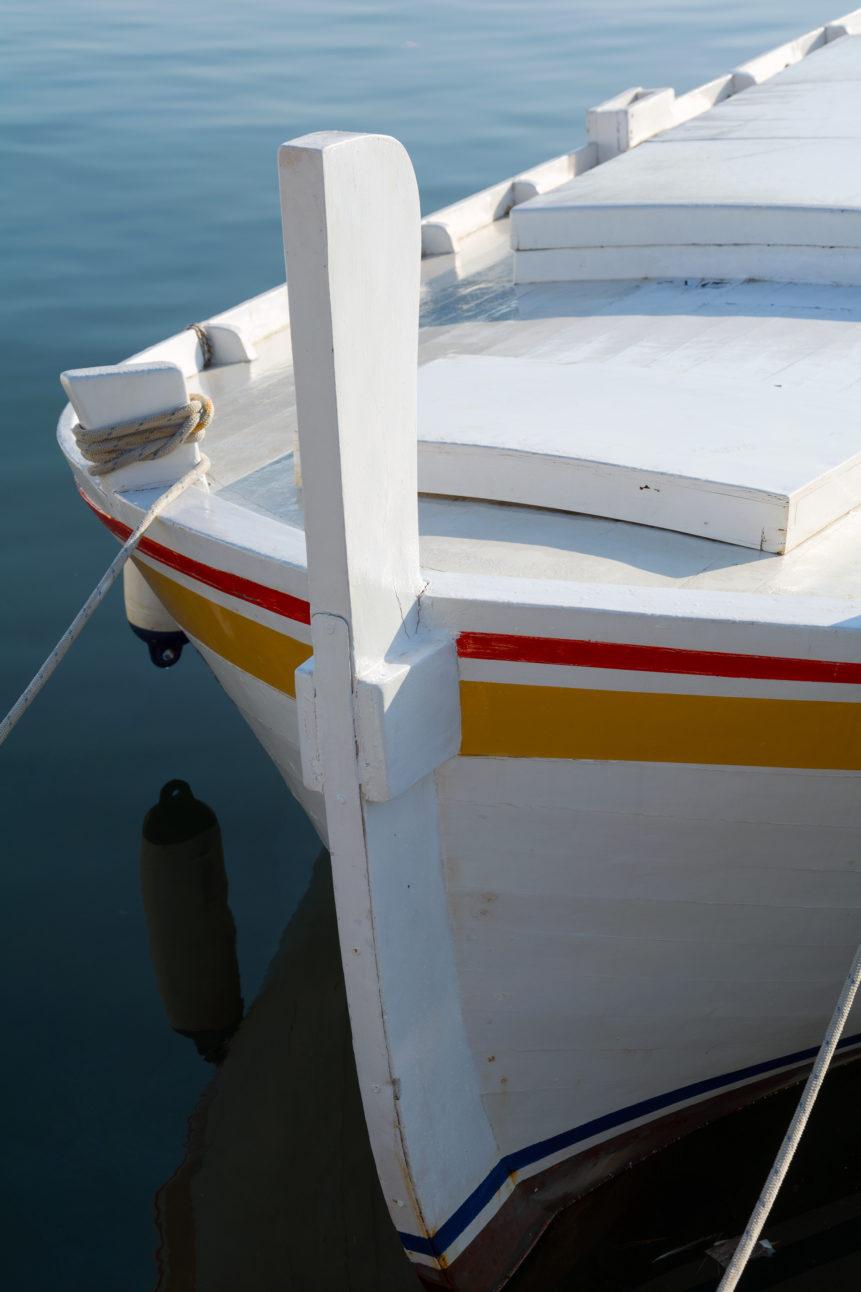 white wooden sea boat
