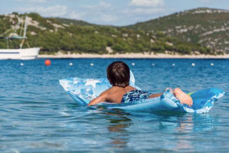 Children on Inflatable Sunbed