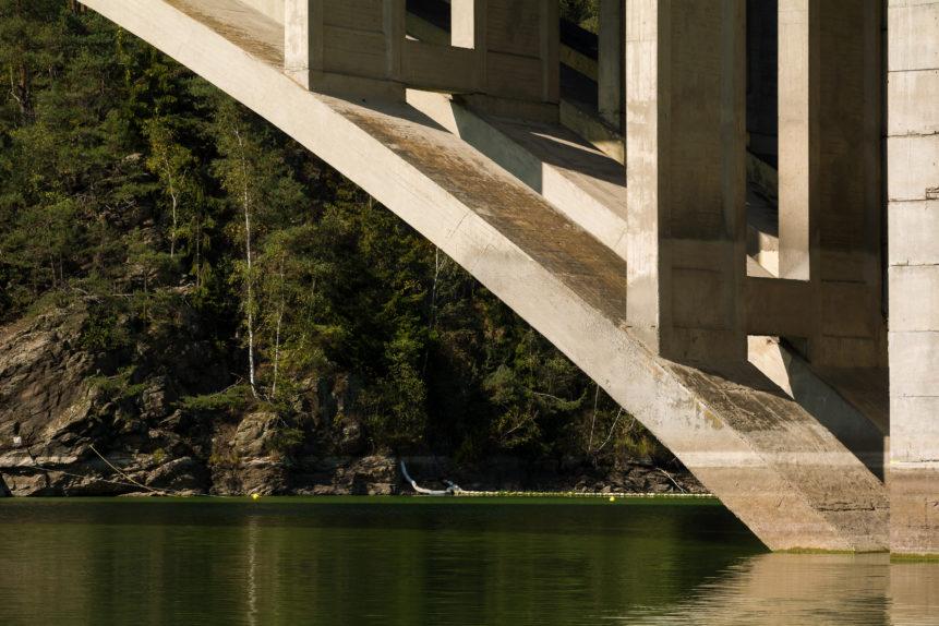 concrete bridge above lake