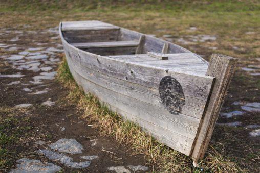Abandoned Wooden Boat on Land